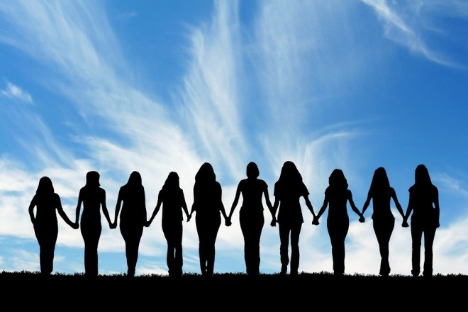 an image showing the silhouette of 10 people holding hands