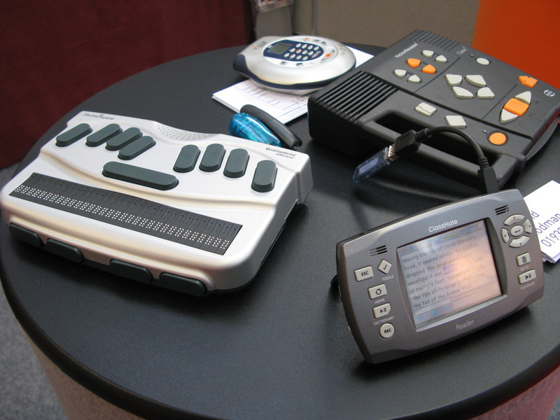 an image showing various items for communication- braille labeller, and text to speech reader.